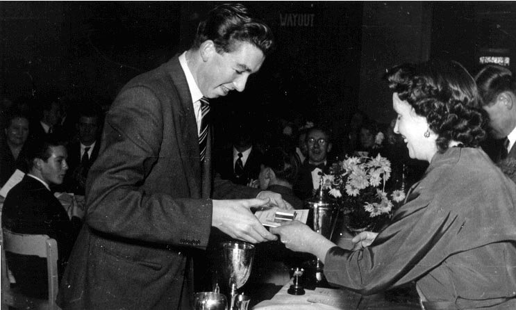 Club dinner 1954. Receiving medals from Mrs Sharpe.